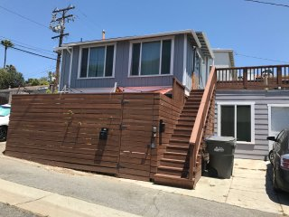 Unit with a huge deck located 2 blocks to the beach