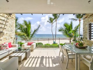 Luxurious oceanfront apartment w/ patio, shared pool, and spectacular sea views