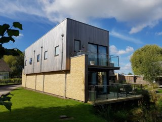 The stunning 4 bedroom No. 1 The Water Gardens, set waterside at The Lower Mill Estate