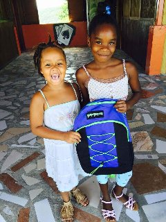 We provide school supplies for local children in need.