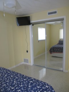 104 closet mirror door with TV on the wall