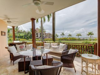 Tropical waterfront elegance w/ furnished patio plus shared pools, gym, tennis