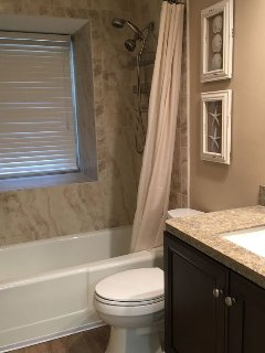 Hall bath w/ all new granite topped vanity, flooring and eco-friendly toilet!