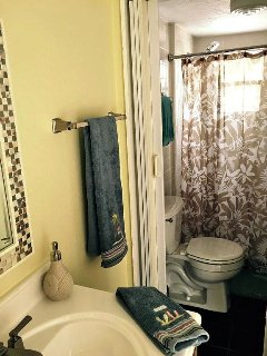 full bathroom. features genuine Jacuzzi massaging shower head!