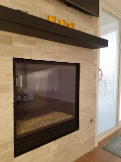 modern gas fireplace with glass stones