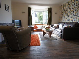 Large bright and spacious living room with dining table for six and free unlimited WI-FI