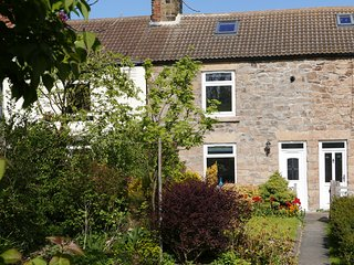 Delightful holiday cottage with panoramic sea views in quiet village