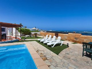 beachfront villa in corralejo with private garden and pool