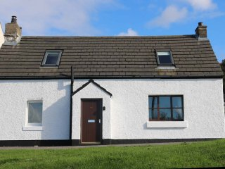 Bayview Cottage, Erbusaig with views of Skye and the Black Cuillin Ridge.