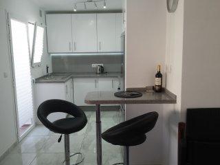 Open plan modern bright kitchen .