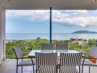 Modern condo with shared pool plus ocean & mountain views - close to town