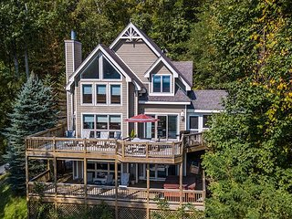 Elegant Home Boasts 2 Stone Fireplaces, Screened Porch, Hot Tub & Dock Slip!