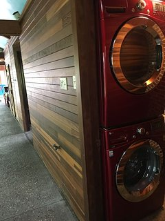 Laundry room in pool suite with new cherry red LG washer and dryer