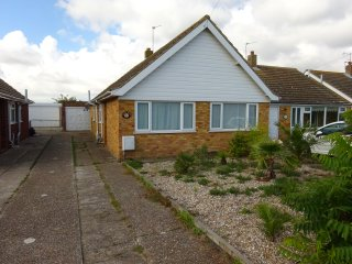 Lovely family bungalow, near beach with the Miniature raliway to rear. Wifi.
