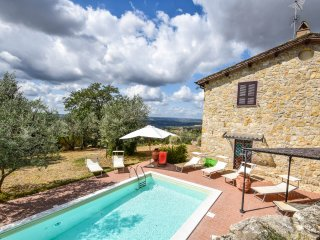 Detached villa with private pool and fenced garden on the outskirts of village