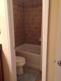 Ground floor bathroom with tub