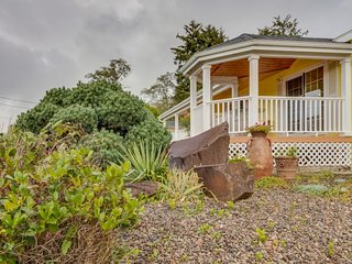 Spacious coastal home with deck, gas fireplace, and partial ocean views