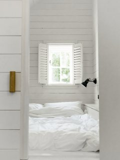 Sleep soundly in the hidden bedroom with electronic black out blinds and luxurious bed linen