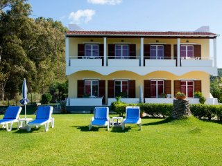 Seafront family Apartments within huge lawn grounds close to the resort center!