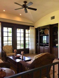 2nd floor TV room with doors to balcony and Ocean views