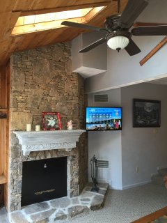 Rustic living room setting with cedar and stone walls. (Note fireplace is locked out)