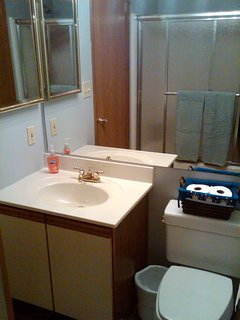 Lockout full bathroom adjoins second master bedroom and hallway.
