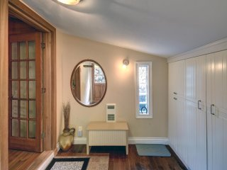 Entry hall with wall of storage closets.