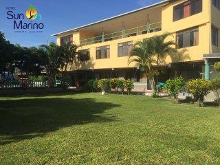 Hotel en Tonsupa con Piscina - hospitalidad, calidad y servicio.