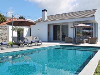 Modern stylish villa, A/C, heated pool, sunny area of Calheta | Calheta Heights