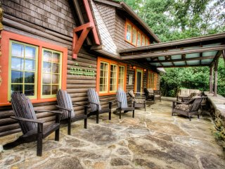 Natural stone porch with plenty of comfortable seating and a hot tub!