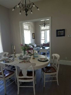 Gracious dining room next to kitchen with table that expands to seat 6+.
