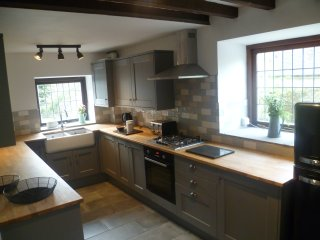 Kitchen with dishwasher, electric oven and gas hob.