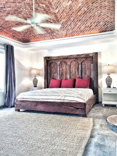 Upstairs custom master bedroom with dome brick ceiling