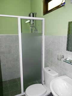 En-suite bathroom with hot water.