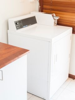 Coin operated washing machine and dryer on site