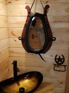 Bathroom,equipped with household water flushing toilet (NOT COMPOST) sink and custom shower