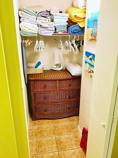 Walk in closet, stocked with lots of towels! Pack lite!