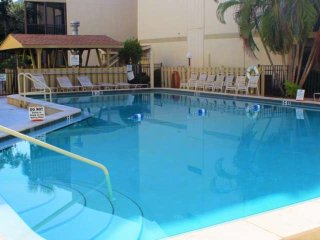 Brand New, Walk to Beach, Wifi, Water view from patio, Heated Pool, On Trolley L