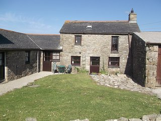JENNY'S COTTAGE, traditional stone cottage with far reaching sea views.