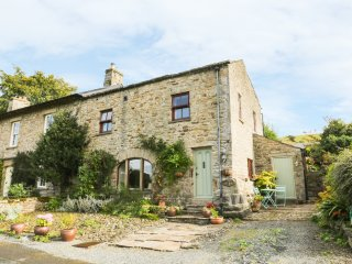BARN COTTAGE, stove, ceiling beams, character, in Newbiggin near Leyburn, Ref