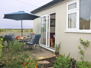PARULA modern coastal home, south west coast path 10 min walk, private patio, of