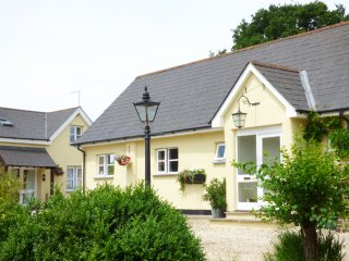 THE OLD DAIRY, open plan layout, garden with furniture, shared swimming pool, in