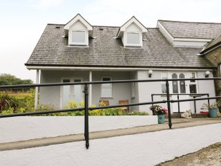 PENLAN VIEW, lovely bungalow, views to Carmarthenshire, compact living, near New