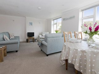 GODREVY is an apartment within the former Porthcurno Hotel, two bedrooms both wi
