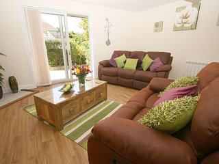GWYNDRA RETREAT modern bungalow, two pets, WiFi, patio garden in St Austell Ref