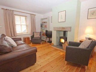 CHURCHGATE COTTAGE, restored terraced cottage with wood burner, enclosed garden,