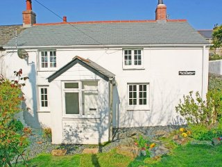 ELFIN COTTAGE, enclosed garden, central location in small harbour town, Ref ****