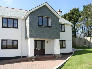 ATLANTIC BREEZE is a modern detached house and sleeps eight in four bedrooms. RE