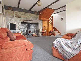 FURNACE COTTAGE, characterful cottage, enclosed garden, rural location near Senn