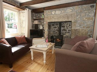 THE PIPPIN is a granite terraced cottage, lawned garden, inglenook fireplace wit